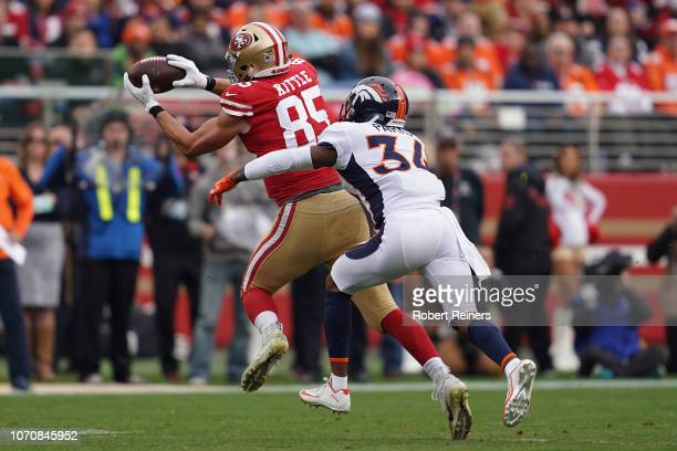 George Kittle of the San Francisco 49ers makes a catch against the Denver Broncos during their NFL game at Levi's Stadium on December 9 2018 in Santa...