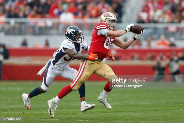 George Kittle of the San Francisco 49ers makes a catch against Will Parks of the Denver Broncos at Levi's Stadium on December 9 2018 in Santa Clara...