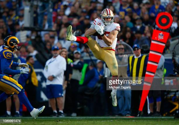 George Kittle of the San Francisco 49ers makes a reception during the game against the Los Angeles Rams at the LA Memorial Coliseum on December 30...