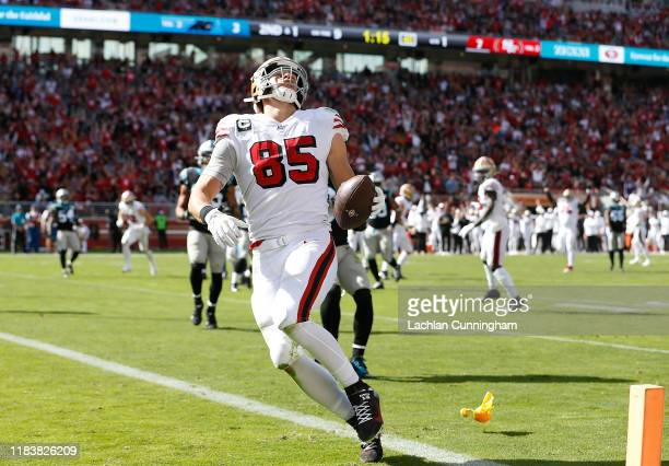 George Kittle of the San Francisco 49ers reacts in the end zone as a flag is thrown for a penalty against Deebo Samuel against Ross Cockrell of the...