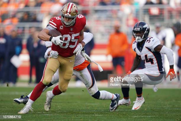 George Kittle of the San Francisco 49ers runs after a catch against the Denver Broncos during their NFL game at Levi's Stadium on December 9 2018 in...