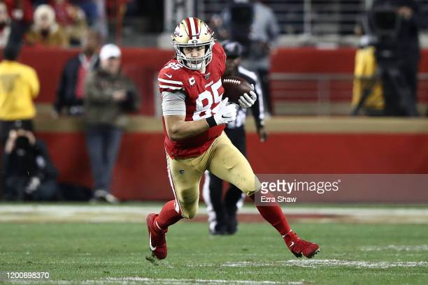 George Kittle of the San Francisco 49ers runs after a catch against the Green Bay Packers during the NFC Championship game at Levi's Stadium on...