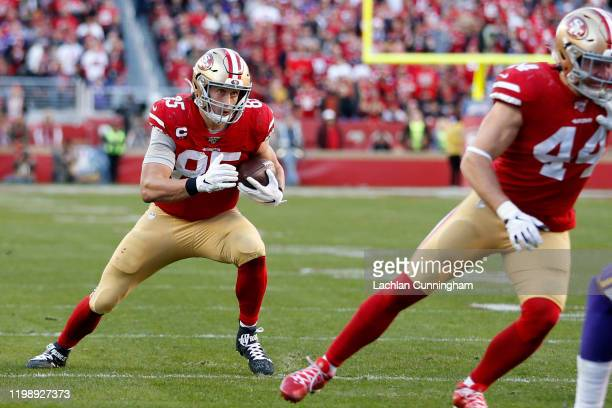 George Kittle of the San Francisco 49ers runs after a catch during the second half against the Minnesota Vikings during the NFC Divisional Round...