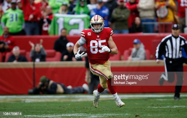 George Kittle of the San Francisco 49ers runs after making a reception during the game against the Seattle Seahawks at Levi's Stadium on December 16...
