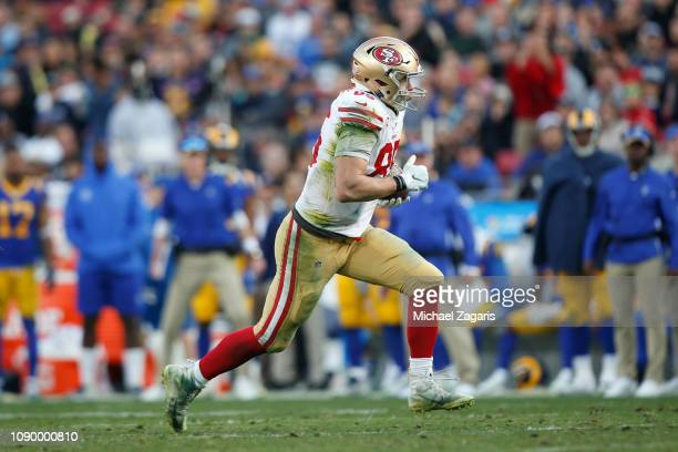 George Kittle of the San Francisco 49ers runs after making a reception during the game against the Los Angeles Rams at the LA Memorial Coliseum on...