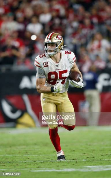 George Kittle of the San Francisco 49ers runs after making a reception during the game against the Arizona Cardinals at State Farm Stadium on October...