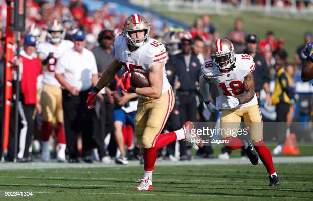 George Kittle of the San Francisco 49ers runs after making a reception during the game against the Los Angeles Rams at Los Angeles Memorial Coliseum...