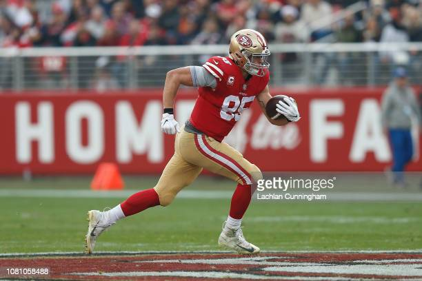 George Kittle of the San Francisco 49ers runs for a 52yard play after making a catch against the Denver Broncos at Levi's Stadium on December 9 2018...
