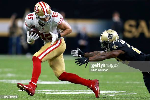 George Kittle of the San Francisco 49ers runs for a first down during a NFL game against the New Orleans Saints at the Mercedes Benz Superdome on...