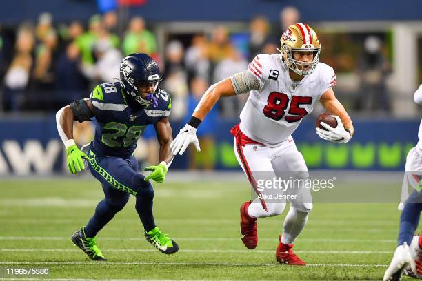 George Kittle of the San Francisco 49ers runs for more yards after a catch from Jimmy Garoppolo during the first quarter of the game against the...