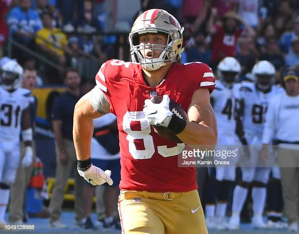 George Kittle of the San Francisco 49ers runs to the end zone after making a reception on an 82yard touchdown pass in the game against the Los...