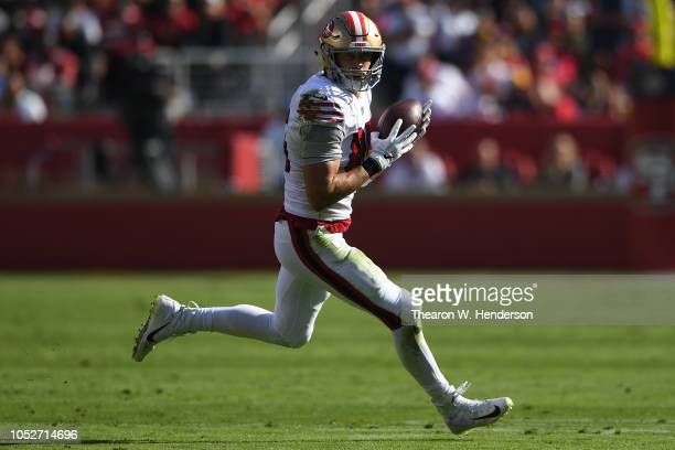 George Kittle of the San Francisco 49ers runs with the ball after a catch against the Los Angeles Rams during their NFL game at Levi's Stadium on...