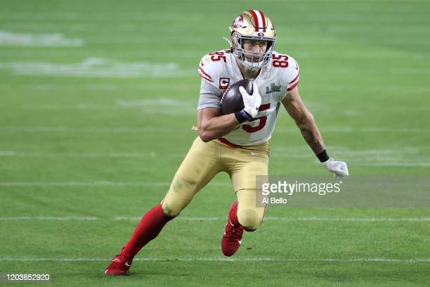 George Kittle of the San Francisco 49ers runs with the ball after a reception against the Kansas City Chiefs during the third quarter in Super Bowl...
