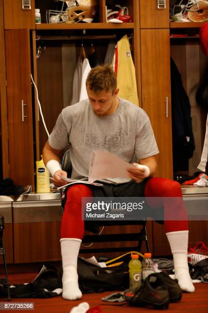 George Kittle of the San Francisco 49ers studies the playbook in the locker room prior to the game against the Arizona Cardinals at Levi's Stadium on...