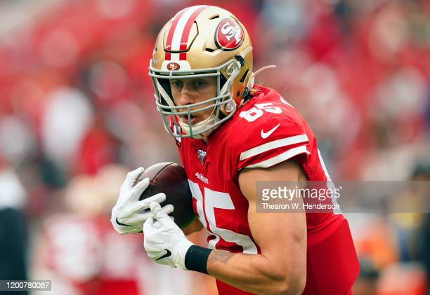 George Kittle of the San Francisco 49ers warms up prior to their game against the Green Bay Packers in the NFC Championship game at Levi's Stadium on...