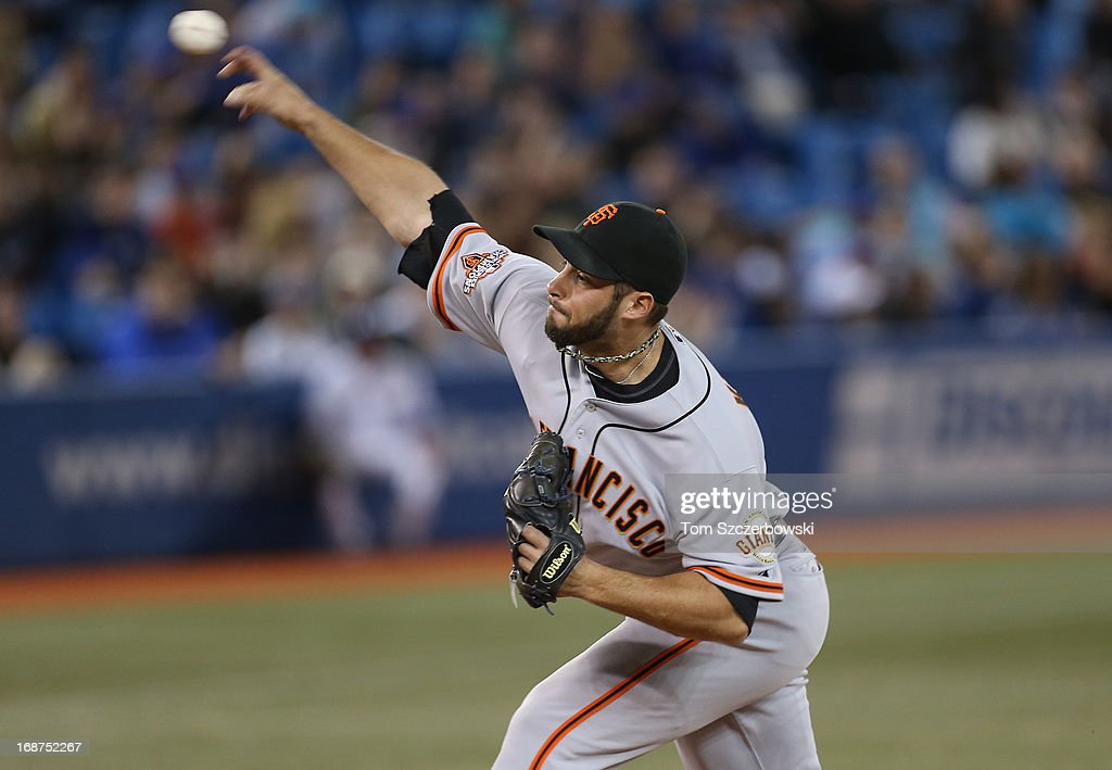 George Kontos #70 of the San Francisco Giants delivers a pitch during MLB game action against the Toronto Blue Jays on May 14, 2013 at Rogers Centre in Toronto, Ontario, Canada.