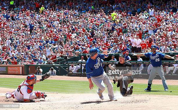 George Kottaras looks on as Geovany Soto of the Texas Rangers shows umpire Bill Miller the ball after tagging out Billy Butler of the Kansas City...