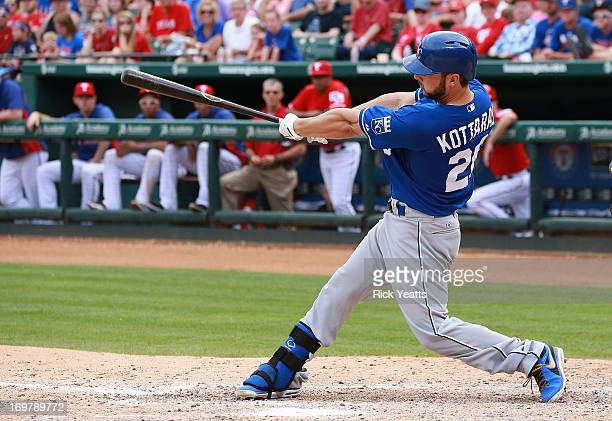 George Kottaras of the Kansas City Royals hits a double into right field bringing in Eric Hosmer and Billy Butler to score against the Texas Rangers...