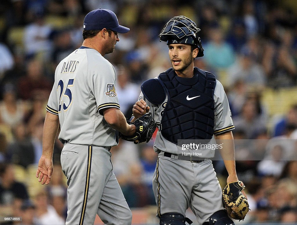 George Kottaras #16 of the Milwaukee Brewers speaks to Doug Davis #25 after giving up a second run to the Los Angeles Dodgers during the first inning at Dodger Stadium on May 5, 2010 in Los Angeles, California.