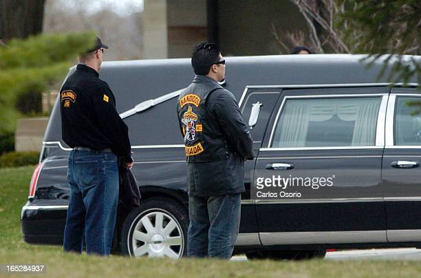 George Kriarakis -- -Two men wearing Bandido clothing stand by as the hearse carrying the body of George Kriarakis is brought to the cementary.