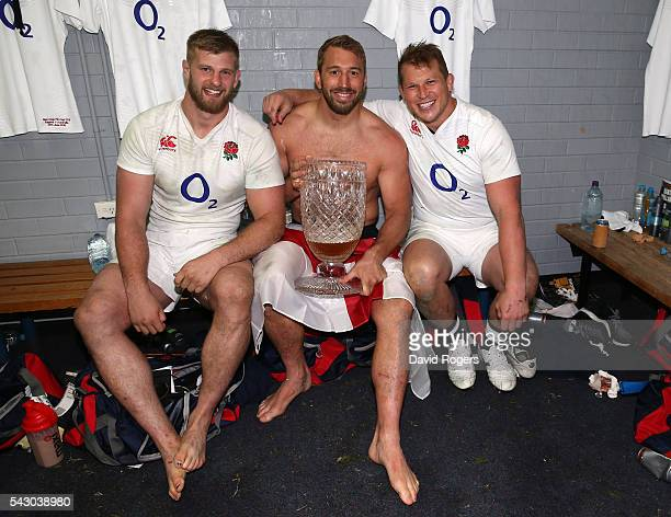 George Kruis Chris Robshaw and Dylan Hartley of England celebrate after their victory during the International Test match between the Australian...
