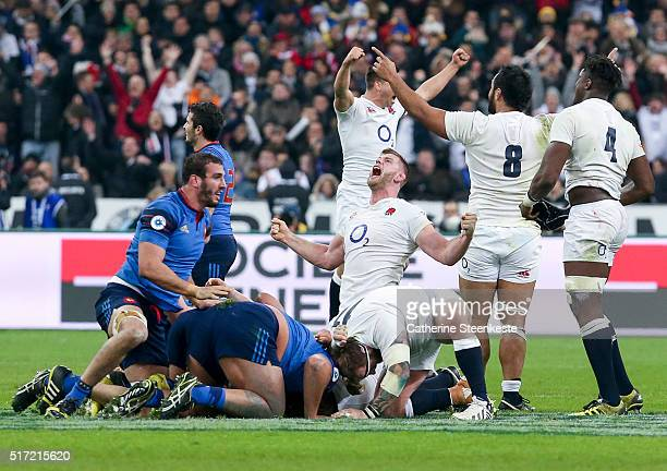 George Kruis of England and his teammates celebrate winning the Grand Slam as the final whistle blows on their 3121 victory of the RBS Six Nations...