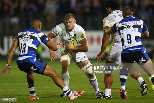 George Kruis of Saracens runs at Jonathan Joseph of Bath during the Aviva Premiership match between Bath Rugby and Saracens at the Recreation Ground...
