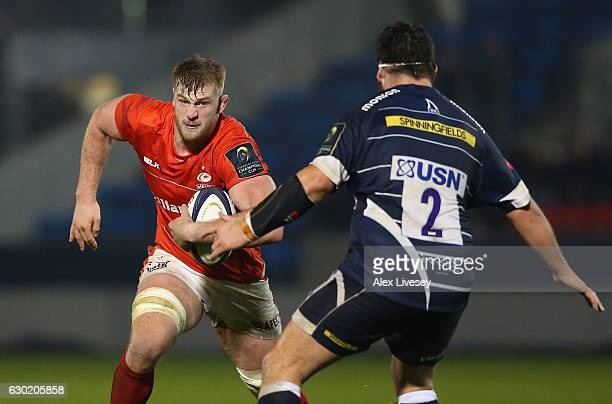 George Kruis of Saracens runs at Rob Webber of Sale Sharks during the European Rugby Champions Cup match between Sale Sharks and Saracens at AJ Bell...