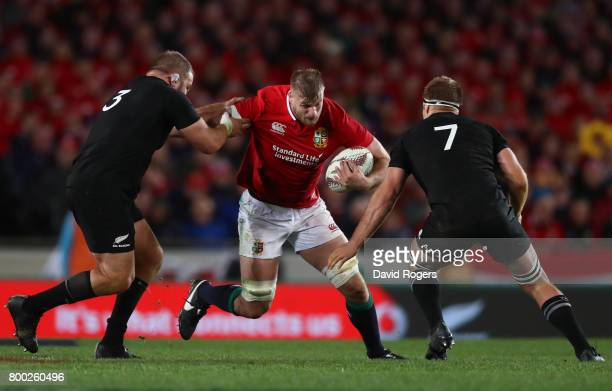 George Kruis of the Lions is tackled by Owen Franks and Sam Cane of the All Blacks during the first test match between the New Zealand All Blacks and...