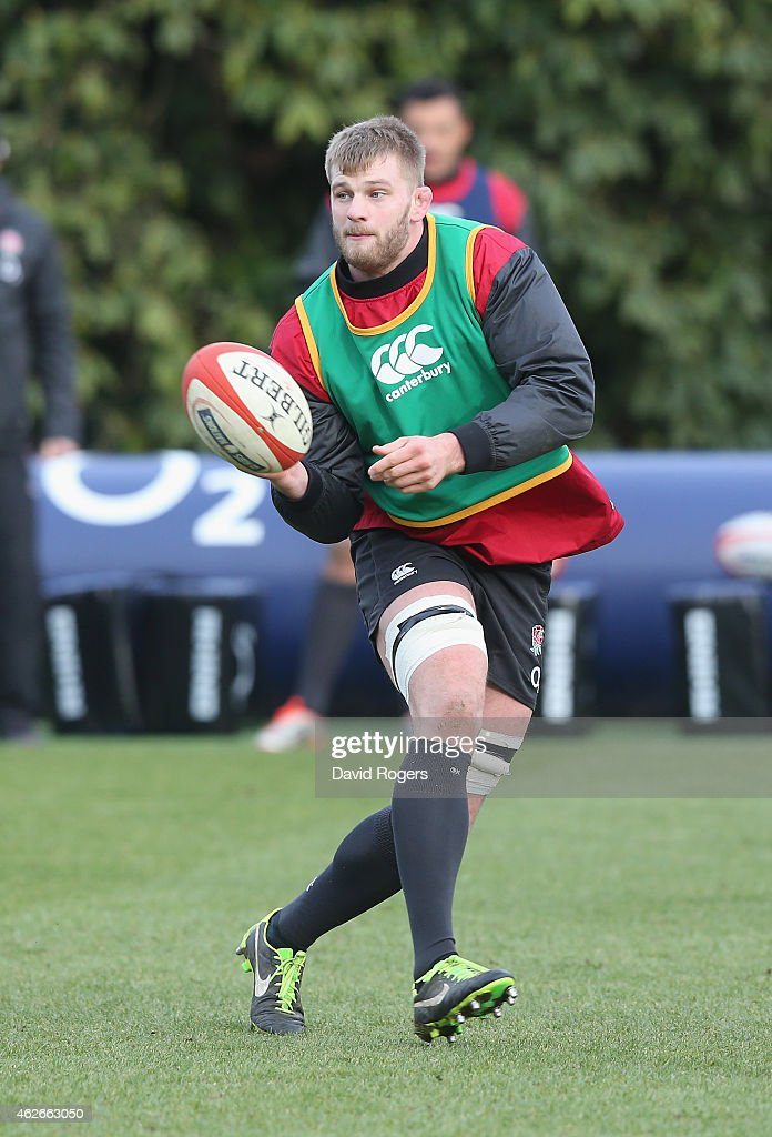 George Kruis passes the ball during the England training session held at Pennyhill Park on February 2, 2015 in Bagshot, England.