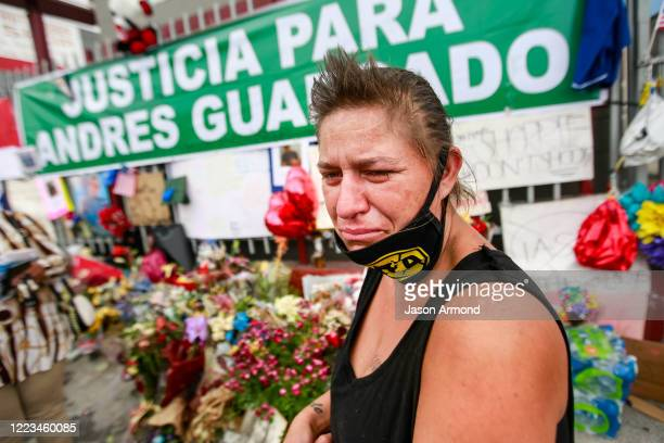 George Laird cries as she recounts how Andres Guardado, who was fatally shot by a sheriff's deputy in Gardena, near where she lives in hear RV on...