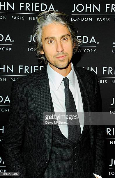 George Lamb arrives at the John Frieda party celebrating 25 years of transforming women's hair at Claridges Hotel on October 29 2013 in London England