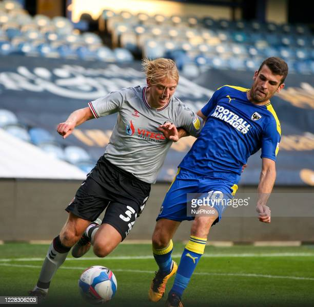 LONDON ENGLAND SEPT 1ST 2020 George Lapslie of Charlton Athletic competes for the ball with Adam Roscrow of AFC Wimbledon during the EFL Trophy match...
