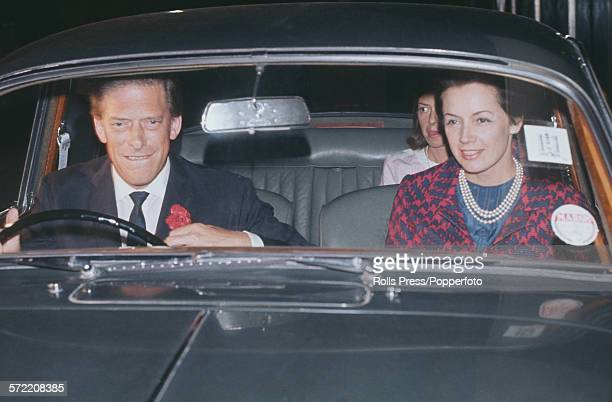 George Lascelles, 7th Earl of Harewood pictured at the wheel of his Jaguar car with his new wife, Australian model Patricia 'Bambi' Tuckwell, as they...