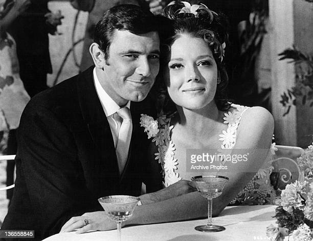 George Lazenby and Diana Rigg as happy newlyweds in a scene from the film 'On Her Majesty's Secret Service', 1969.