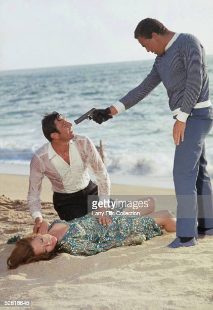 George Lazenby as James Bond and Diana Rigg as Contessa Teresa Di Vicenzo fall foul of henchman Raphael, played by Terry Mountain, in a scene from...