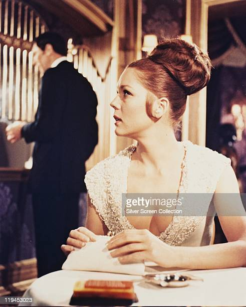 George Lazenby Australian actor and Diana Rigg British actress in a publicity still for the film 'On Her Majesty's Secret Service' 1969 The spy film...
