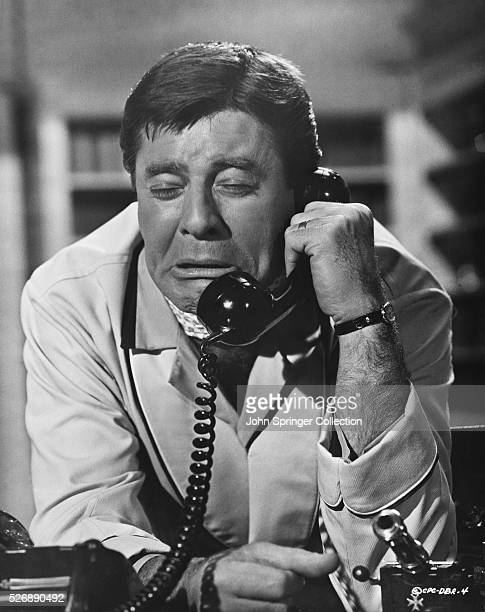George Lester cries while making a telephone call in a scene from the 1967 film Don't Raise the Bridge Lower the River directed by Jerry Paris The...