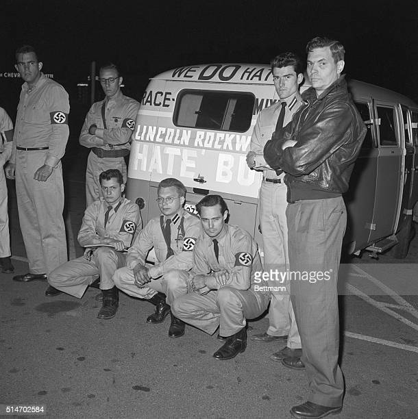 George Lincoln Rockwell and followers of his American Nazi party pose next to the Hate Bus a Volkswagen they use to drive around the country and...