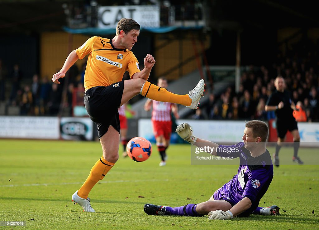 George Long of Sheffield United blocks a shot by Adam Cunnington of Cambridge United during the FA Cup Second Round match between Cambridge United and Sheffield United at the Abbey Stadium on December 8, 2013 in Cambridge, Cambridgeshire.