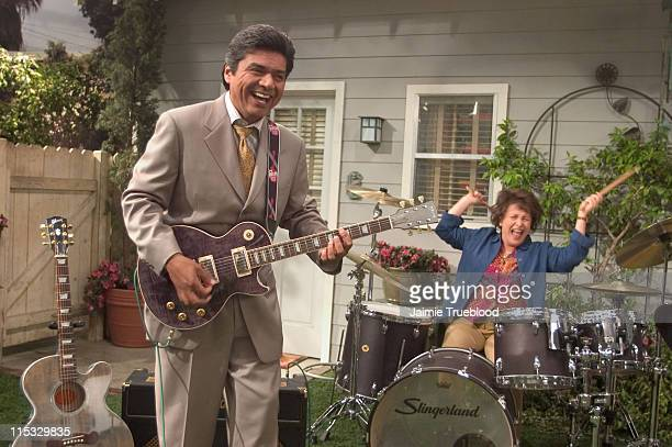 George Lopez and Belita Moreno who star on the ABC primetime hit series The George Lopez Show play their Gibson Trans Black Les Paul and Slingerland...