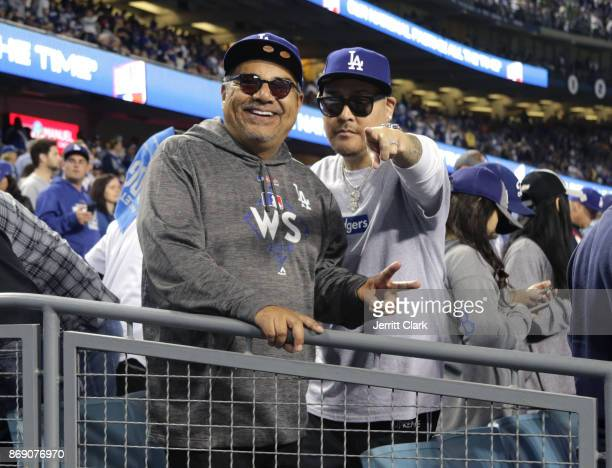 George Lopez and Ben Baller attend game six of the 2017 World Series at Dodger Stadium on October 31 2017 in Los Angeles California