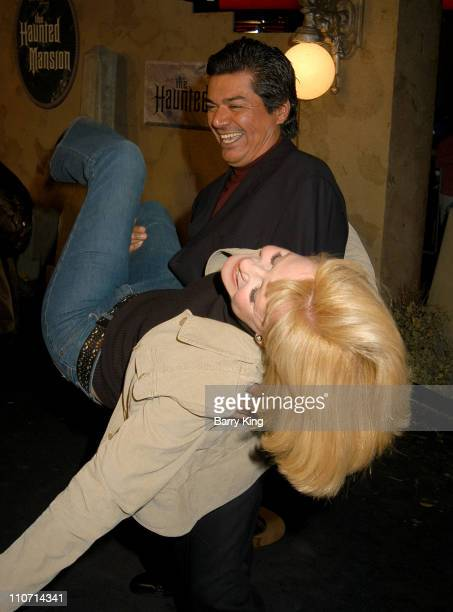 George Lopez and Bonnie Hunt during The Haunted Mansion World Premiere at El Capitan Theatre in Hollywood California United States