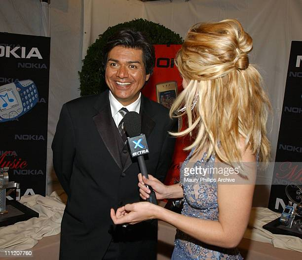 George Lopez and Dayna Devon during The 55th Annual Primetime Emmy Awards Nokia Red Carpet at The Shrine Theater in Los Angeles California United...