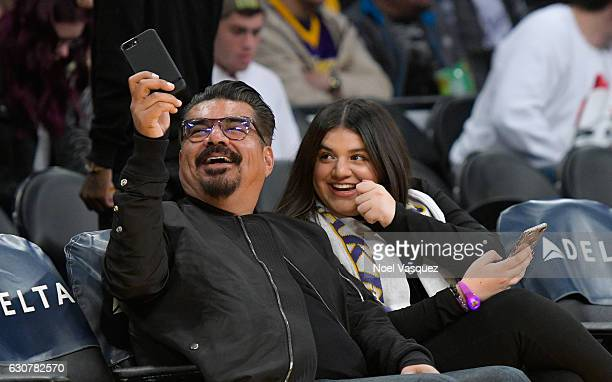 George Lopez and Maya Lopez attend a basketball game between Toronto Raptors and the Los Angeles Lakers at Staples Center on January 1 2017 in Los...