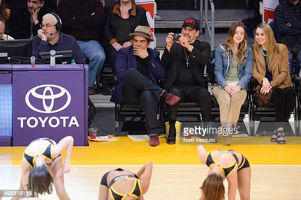 George Lopez Danny Trejo and Lorraine Nicholson attend a basketball game between the Charlotte Bobcats and the Los Angeles Lakers at Staples Center...