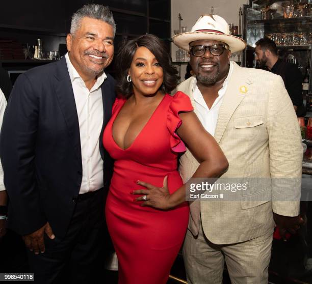 George Lopez Niecy Nash and Cedric The Entertainer pose for a photo at the celebration honoring Niecy Nash as she is honored with a Star On The...
