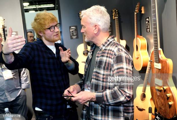 George Lowden and Ed Sheeran pose in the Lowden booth at the 2019 NAMM Show opening day at the Anaheim Convention Center on January 24 2019 in...