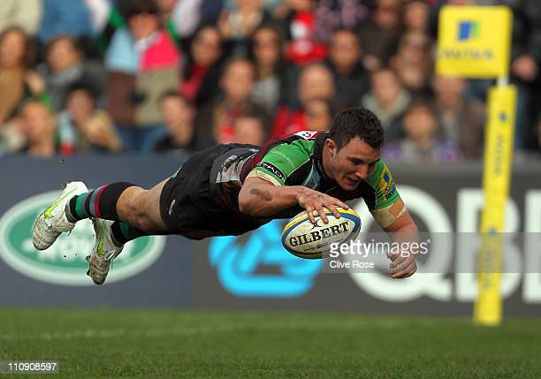 George Lowe of Harlequins dives over for a try during the Aviva Premiership match between Harlequins and Gloucester at The Stoop on March 26 2011 in...