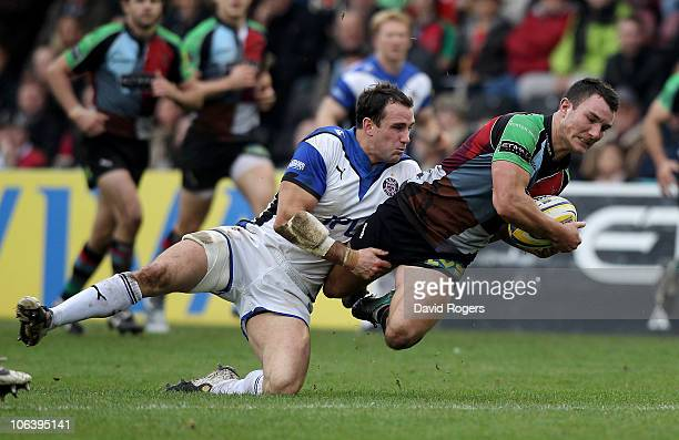 George Lowe of Harlequins is tackled by Matt Carraro during the Aviva Premiership match between Harlequins and Bath at the Stoop on October 31 2010...